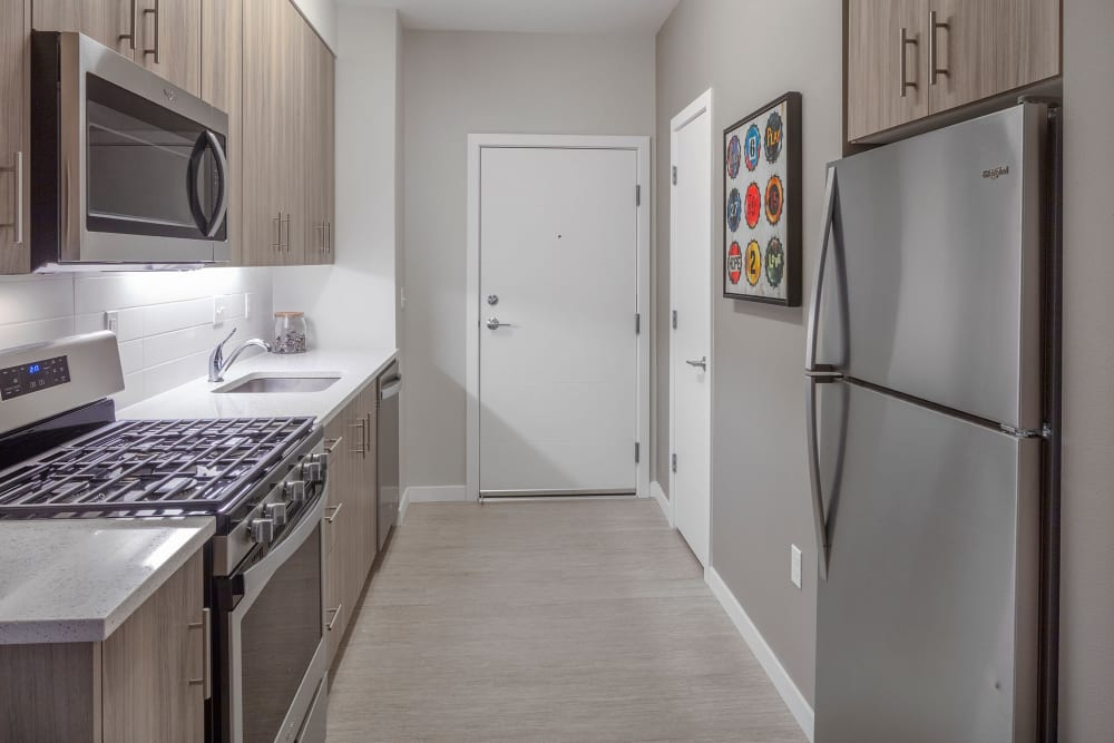 Kitchen with stainless steel appliances at Division Terrace in Portland, Oregon