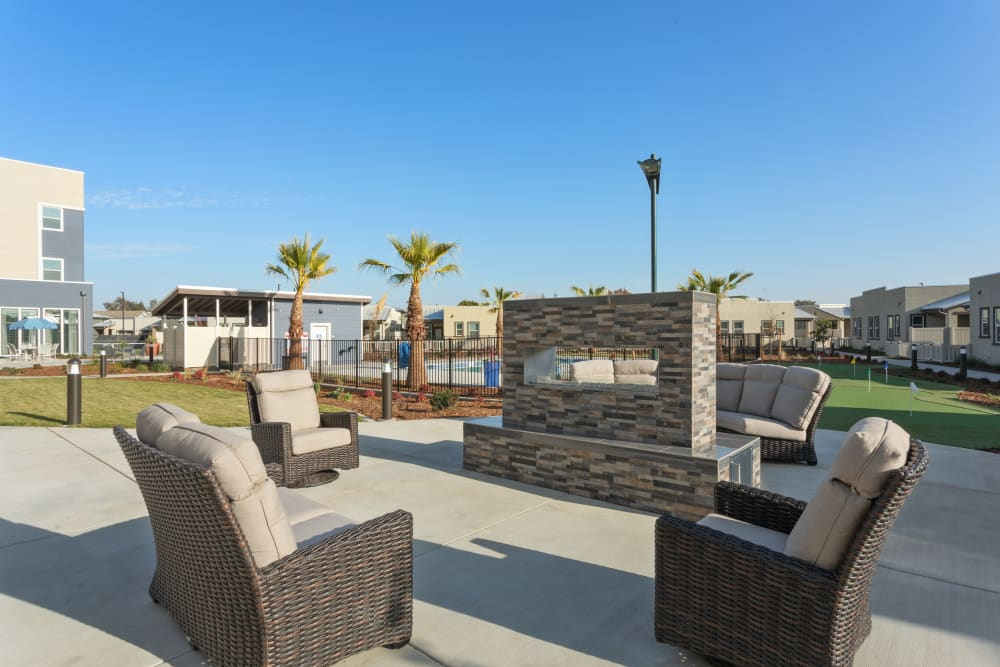 Outdoor fireplace and chairs at WellQuest of Elk Grove in Elk Grove, California