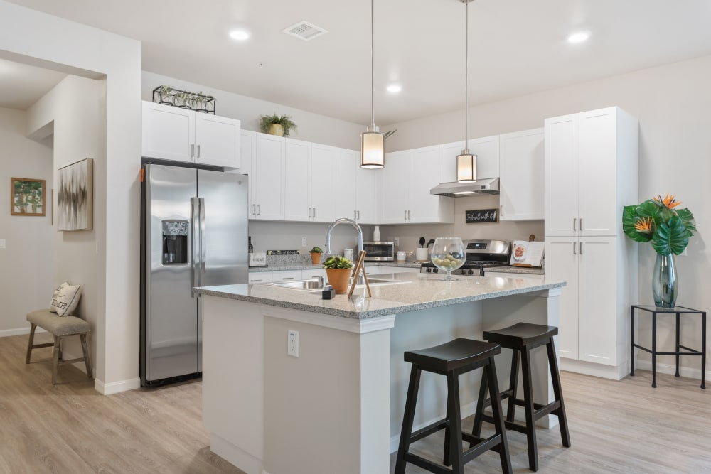 kitchen sink island with bar seating at WellQuest of Elk Grove in Elk Grove, California