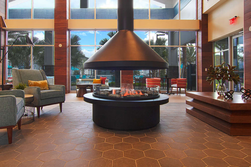 Fireplace and seating at Integra Crossings in Sanford, Florida