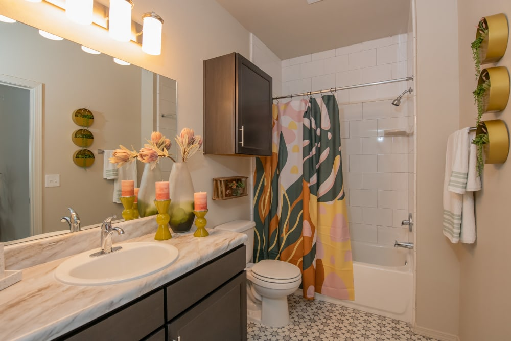 Cute bathroom with lots of lighting at Artisan Crossing in Norman, Oklahoma