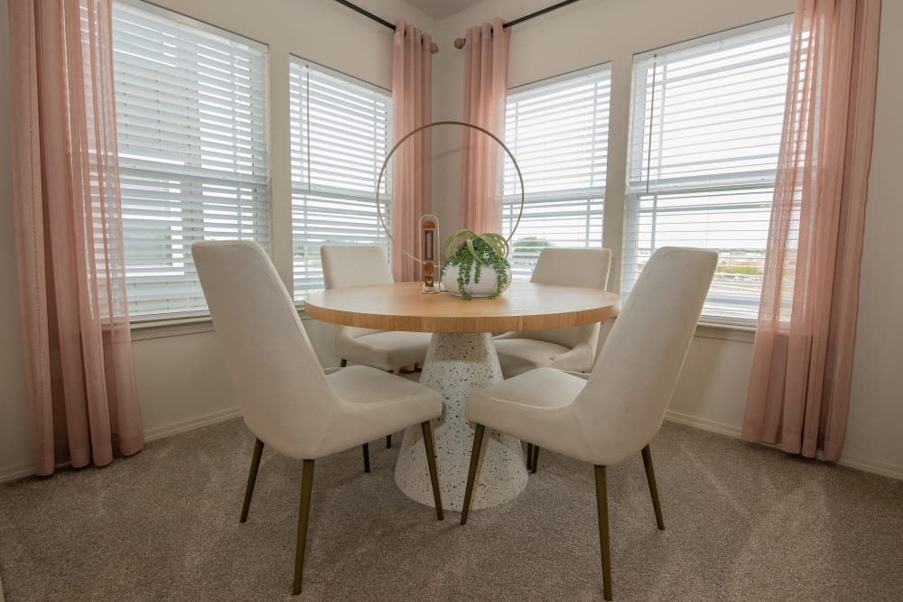 Dining area with large windows for lots of light at Artisan Crossing in Norman, Oklahoma