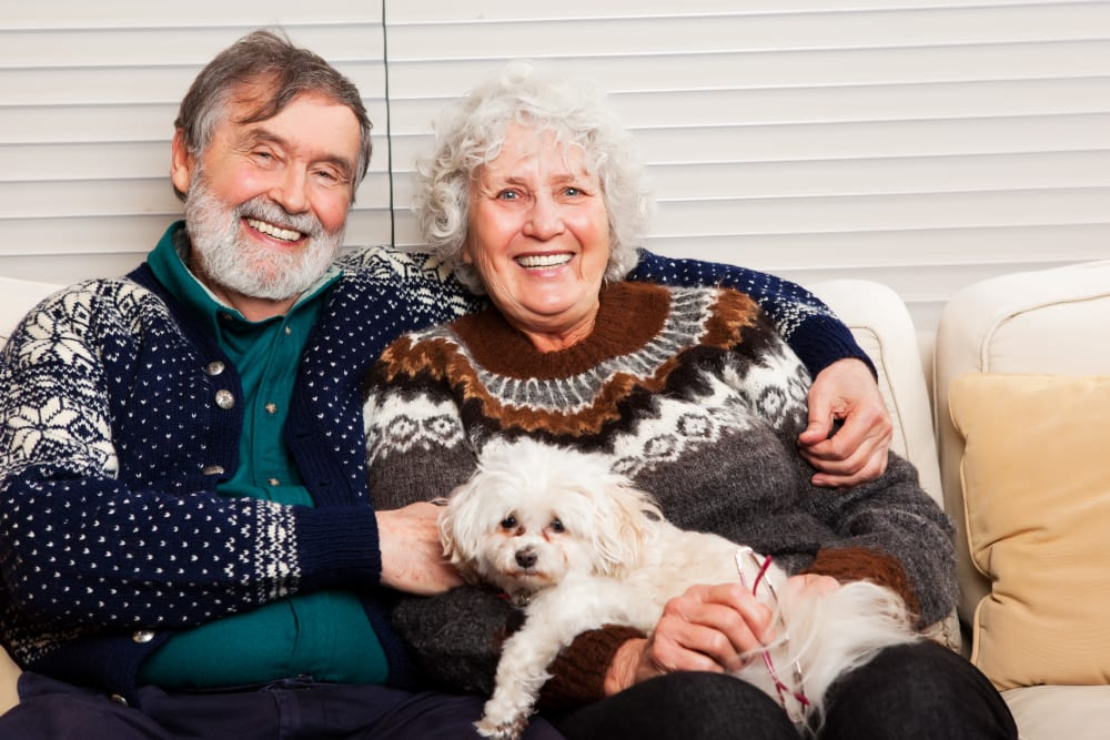 A couple at Absaroka Senior Living in Cody, Wyoming with their dog