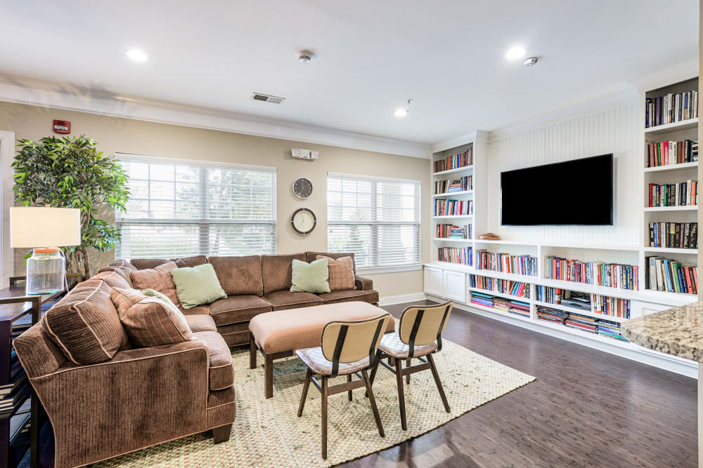 Clubhouse seating area with tv at Oasis at Montclair Apartments in Dumfries, Virginia