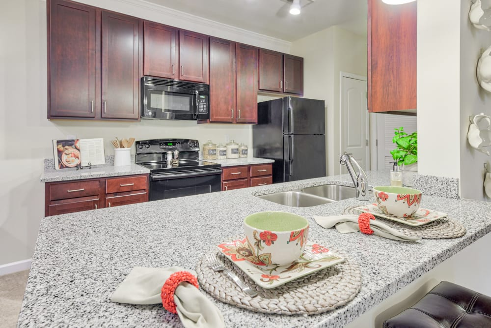 Kitchen at Oasis at Montclair Apartments in Dumfries , VA