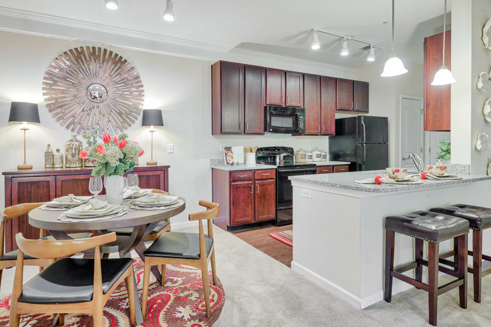 View of dining area into kitchen at Oasis at Montclair Apartments in Dumfries , VA