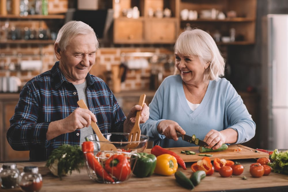 A resident couple cooking together at Absaroka Senior Living in Cody, Wyoming