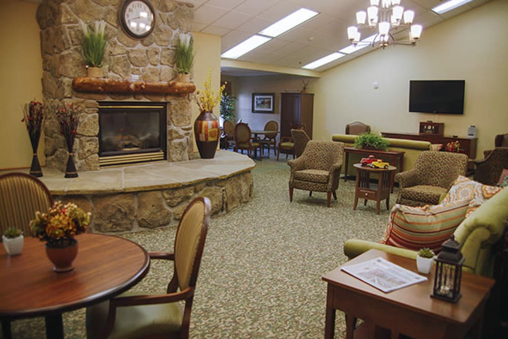 A mountain inspired common room with fireplace at Absaroka Senior Living in Cody, Wyoming