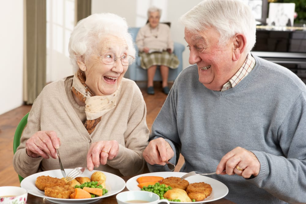Two residents enjoying a meal at Absaroka Senior Living in Cody, Wyoming