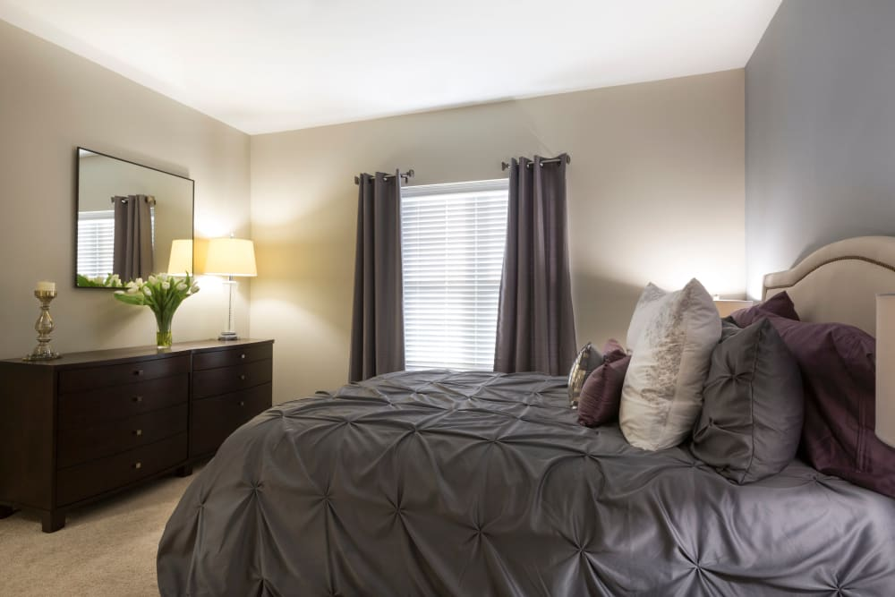 Bedroom with a large window at Regency Place in Wilmington, Massachusetts