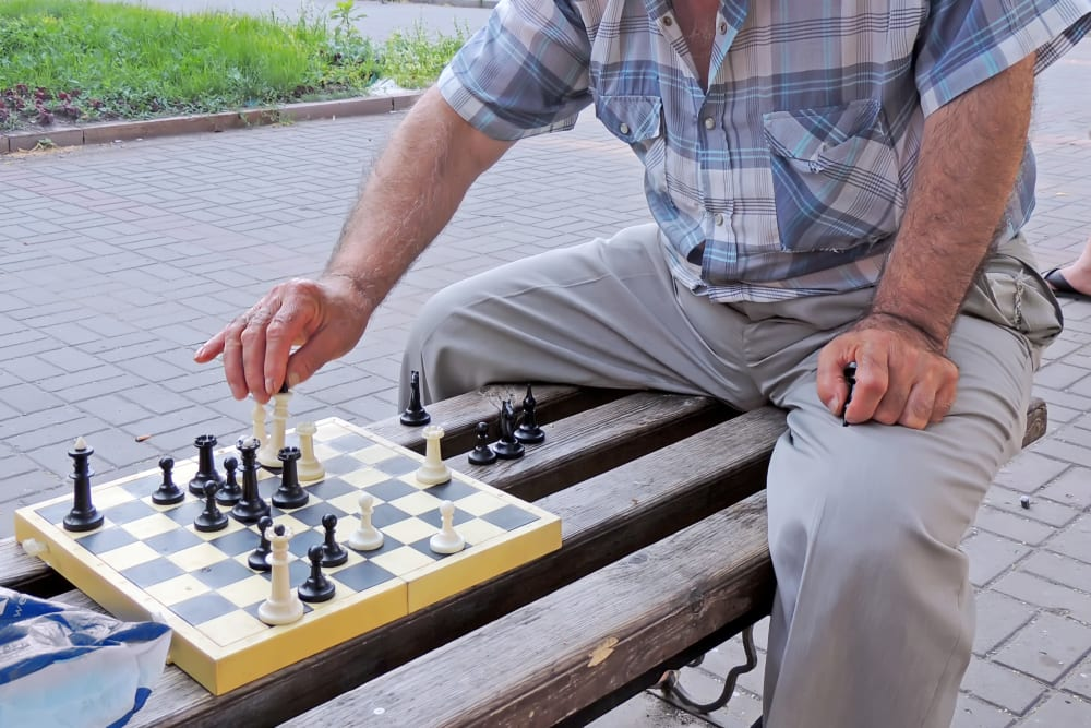 A man playing chess at The Iris Senior Living in Great Falls, Montana
