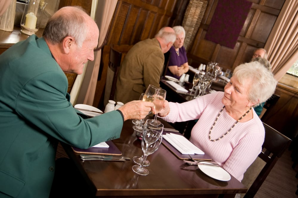 Residents dining in restaurant at The Iris Senior Living in Great Falls, Montana