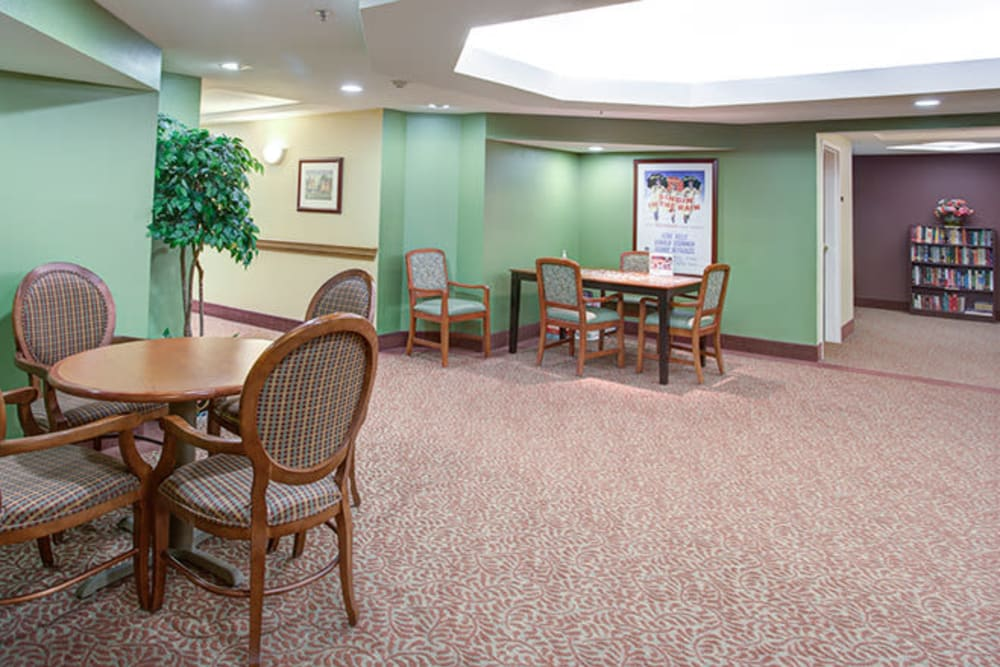 Open common space with tables at The Iris Senior Living in Great Falls, Montana