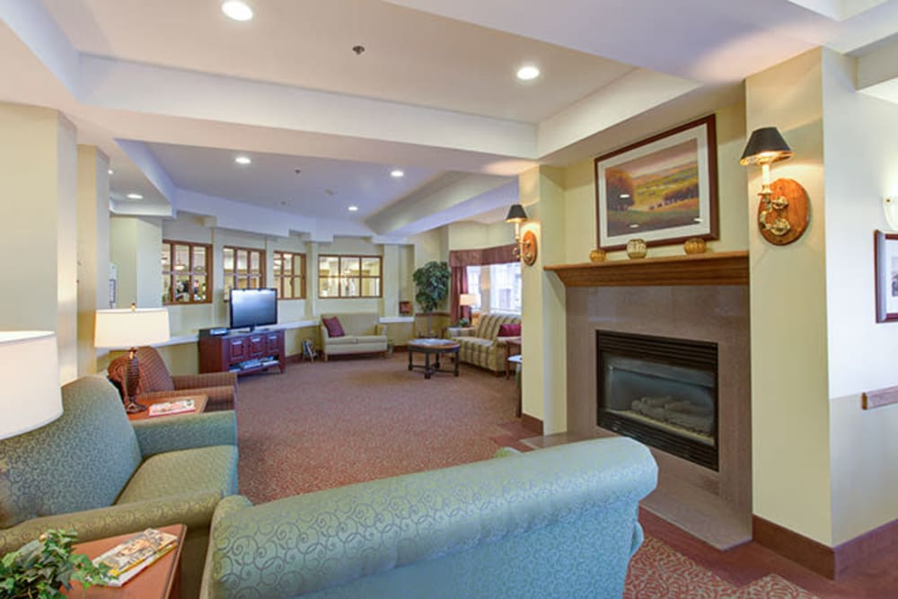 Resident common area with fireplace at The Iris Senior Living in Great Falls, Montana