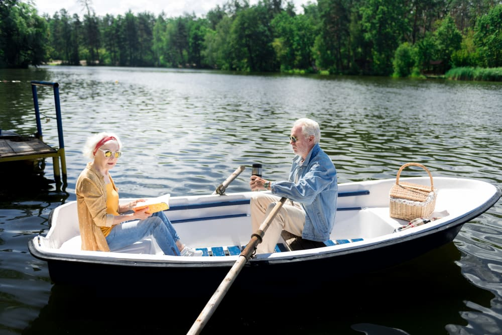 Two residents in a canoe at a lake near at The Iris Senior Living in Great Falls, Montana