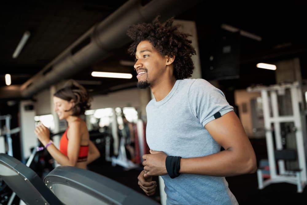 Resident running on a treadmill at Mandalane Apartments in Wheeling, Illinois