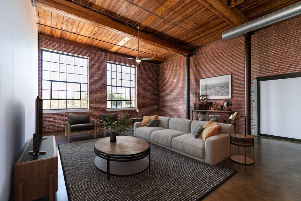 Living room with industrial style design at The Lofts at Swift Mill in Columbus, Georgia