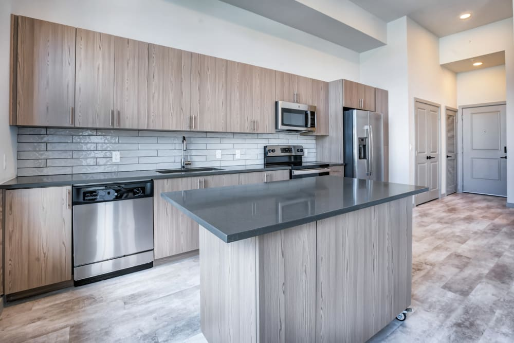 Kitchen with large island at The District Flats in West Palm Beach, Florida