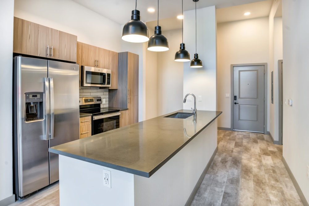 Stainless-steel appliances in expansive kitchen at The District Flats in West Palm Beach, Florida