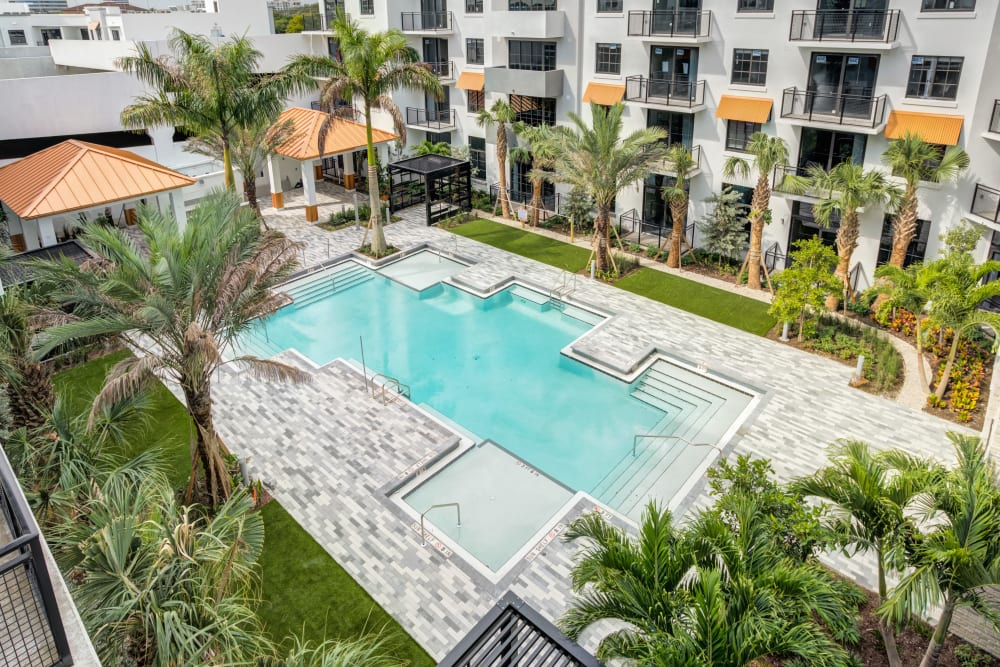 Resort-style swimming pool at The District Flats in West Palm Beach, Florida
