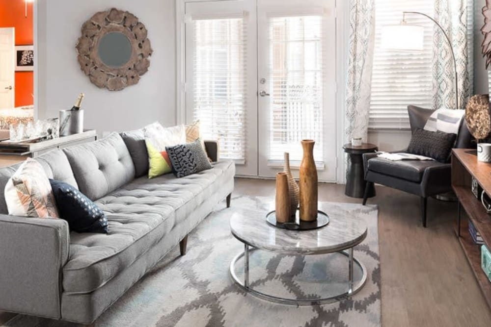 Living room with wood style flooring at Alesio Urban Center in Irving, Texas