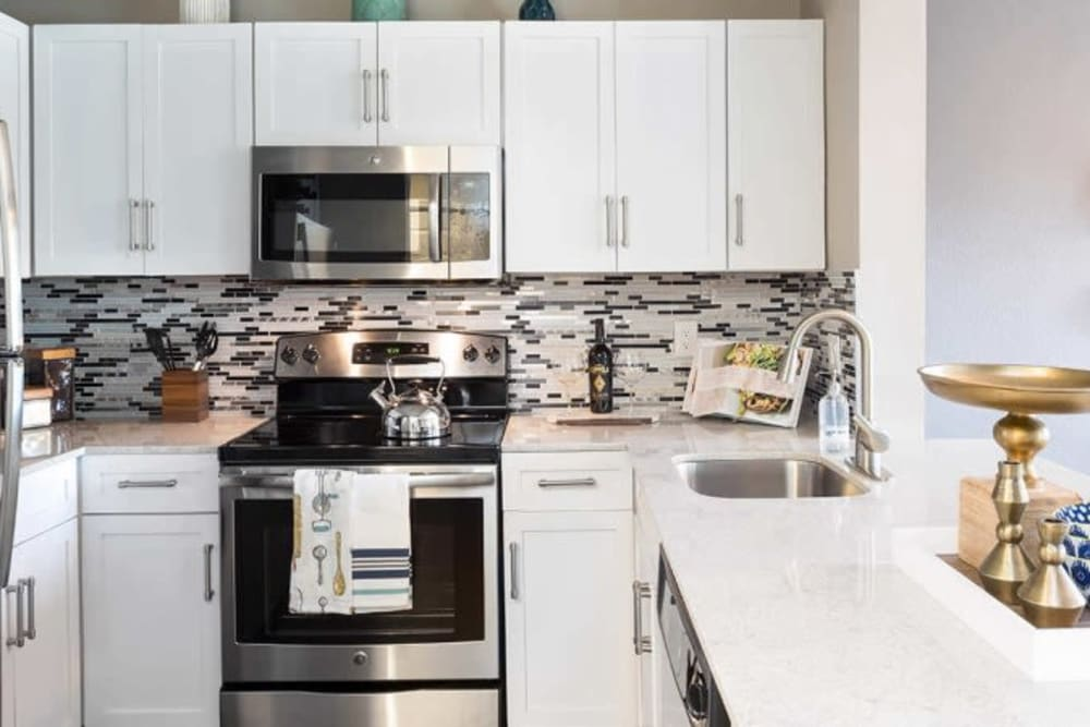 Bright kitchen with subway tile at Alesio Urban Center in Irving, Texas