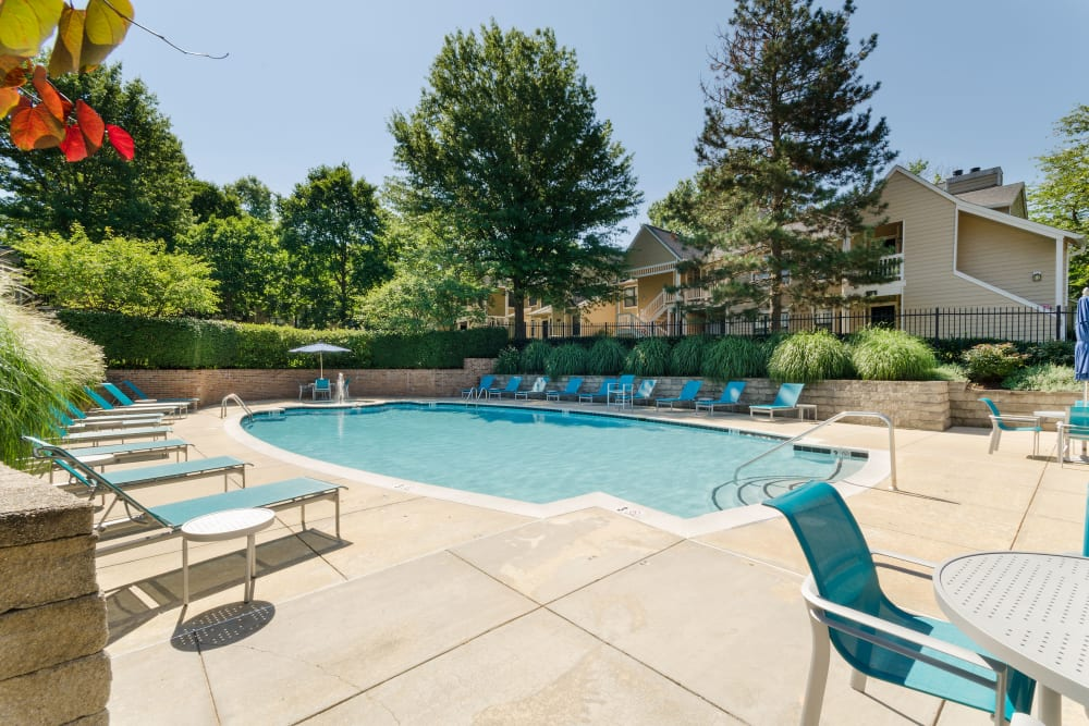 Pool and deck chairs at Eagle Rock Apartments at Columbia in Columbia, Maryland