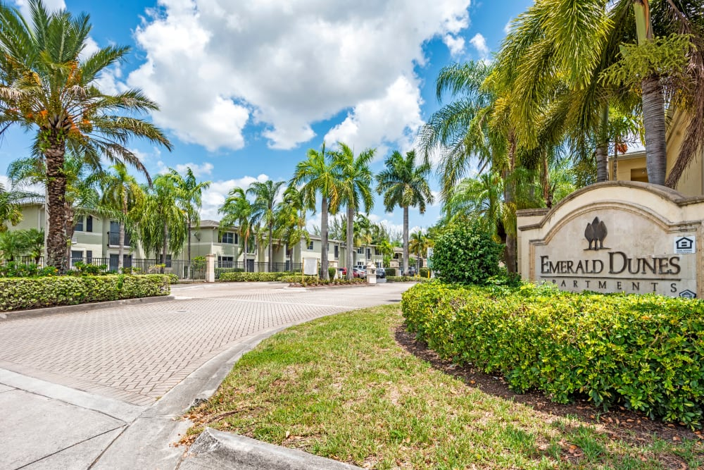 A beautifully manicured entrance at Emerald Dunes Apartments in Miami Gardens, Florida