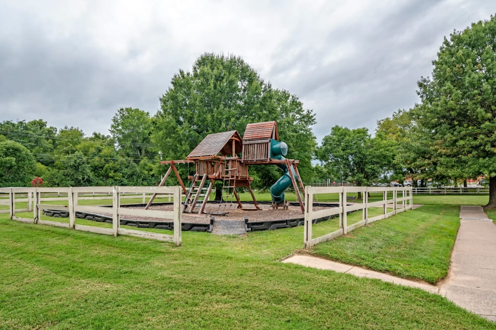 A playground surrounded by grass at Green Wood in Gallatin, Tennessee