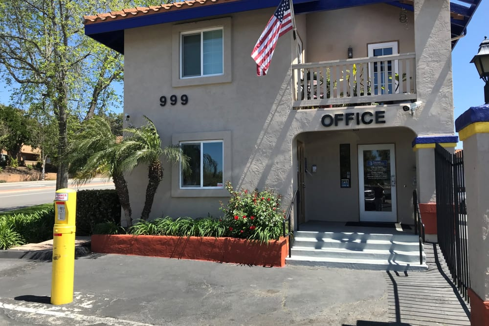 Exterior office with security gate at Storage Solutions in San Marcos, California