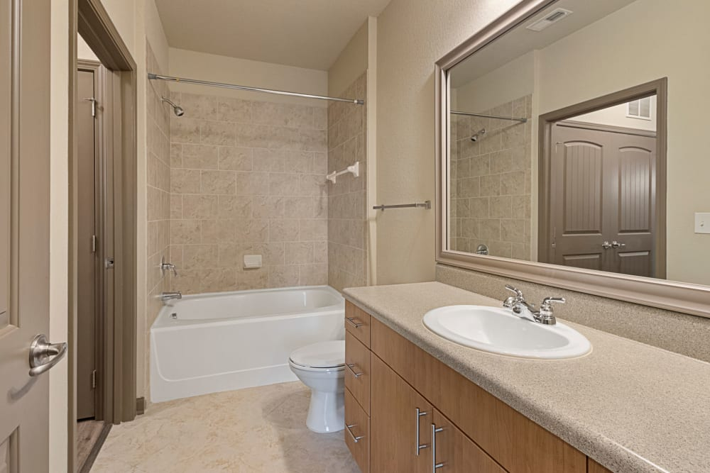Large bathroom with shower tub at The Addison at South Tryon in Charlotte, North Carolina