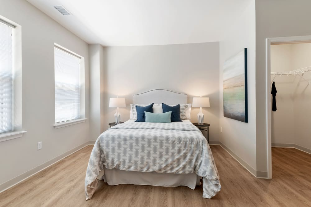 Bedroom with lots of natural light at The Apartments at Sharpe Square in Frederick, Maryland