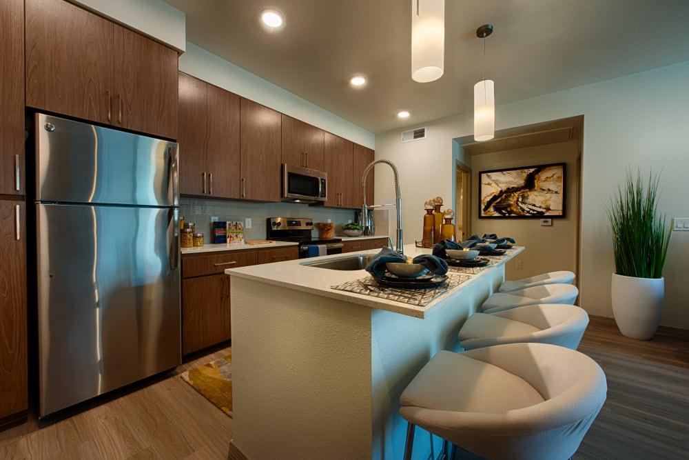 Kitchen with granite countertops at Ocio Plaza Del Rio in Peoria, Arizona