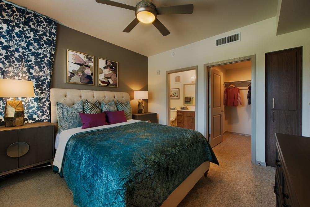 Primary bedroom with a bathroom at Ocio Plaza Del Rio in Peoria, Arizona