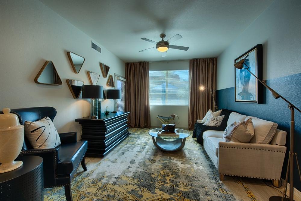 Bright, spacious living room at Ocio Plaza Del Rio in Peoria, Arizona