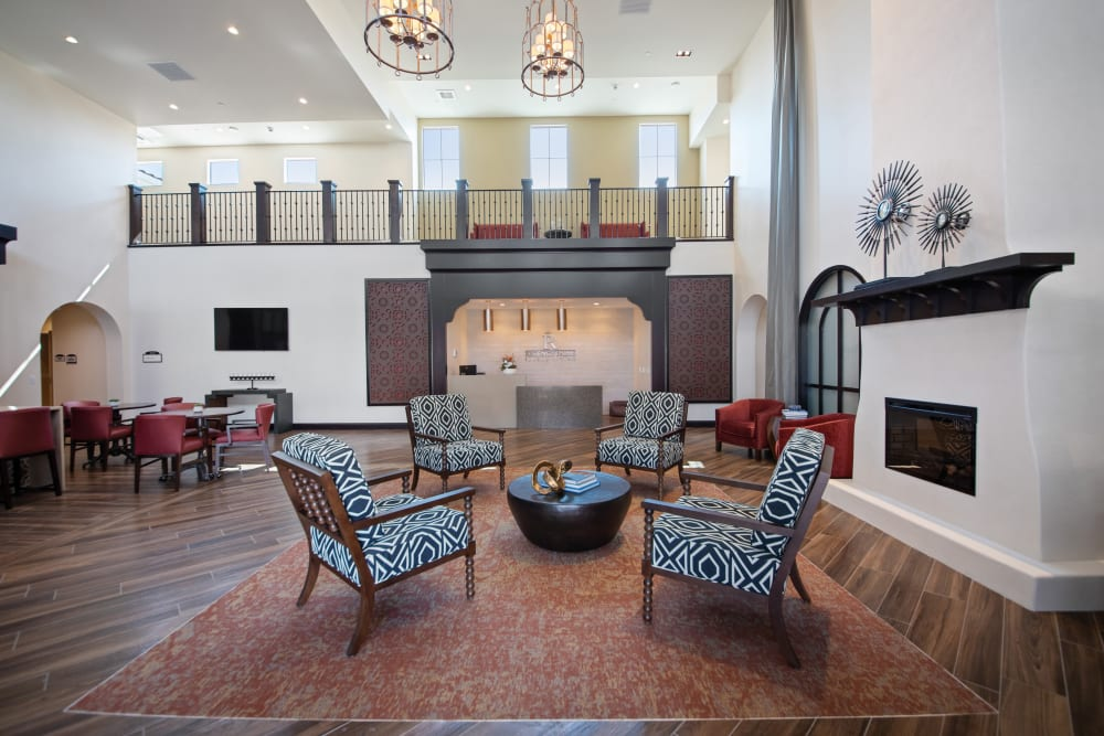 Main lobby with a fireplace and large reception area at Regency Palms Oxnard in Oxnard, California
