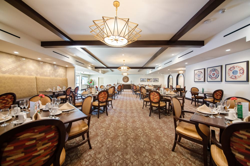 Main dining hall with hardwood floors at Regency Palms Oxnard in Oxnard, California