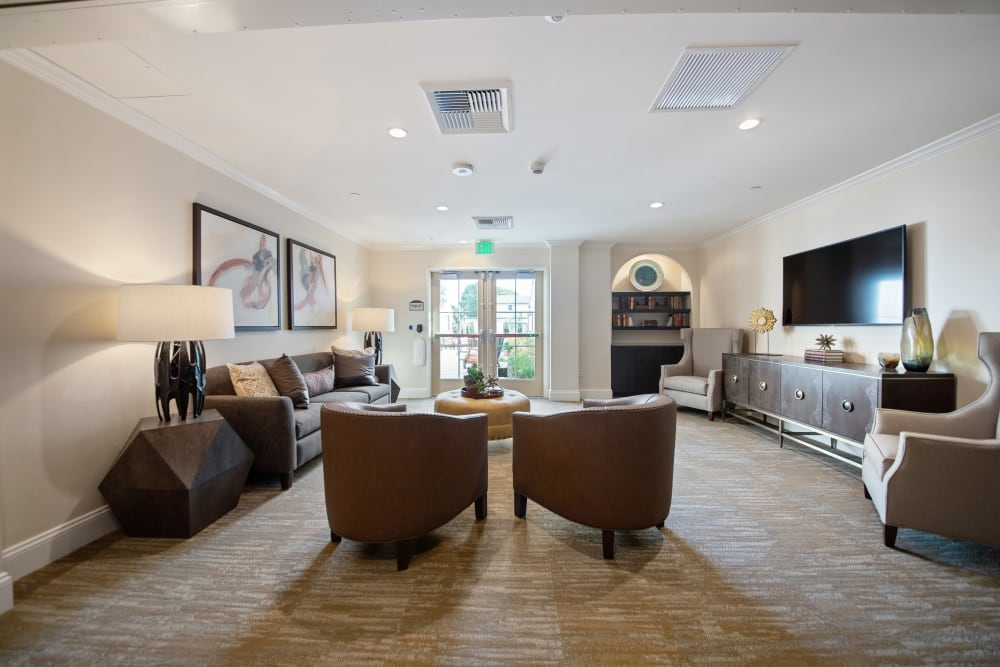 Lounge with chairs and a tv at Regency Palms Oxnard in Oxnard, California