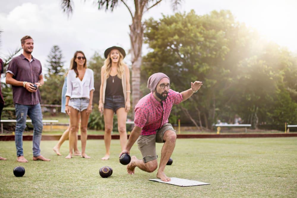Friends lawn bowling near Ikon Athens in Athens, Georgia