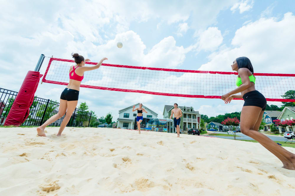 Residents playing some volleyball on the sand court at Ikon Athens in Athens, Georgia