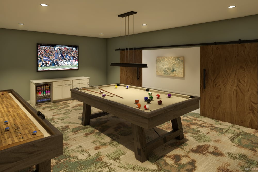 game room with tv and pool table