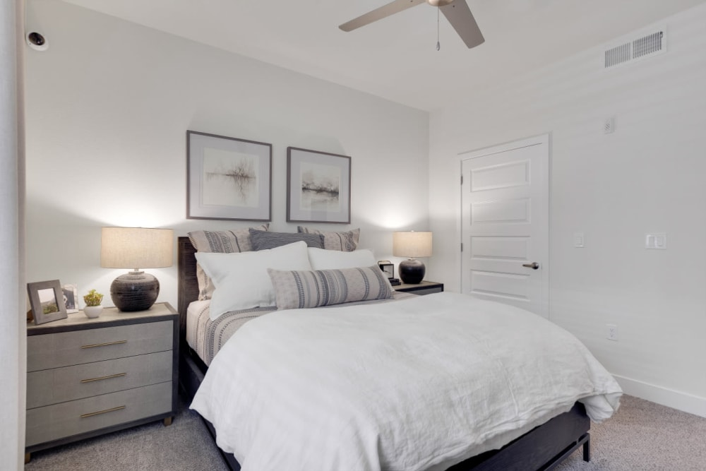 Plush carpeting and a ceiling fan in a model home's bedroom at Olympus Rodeo in Santa Fe, New Mexico