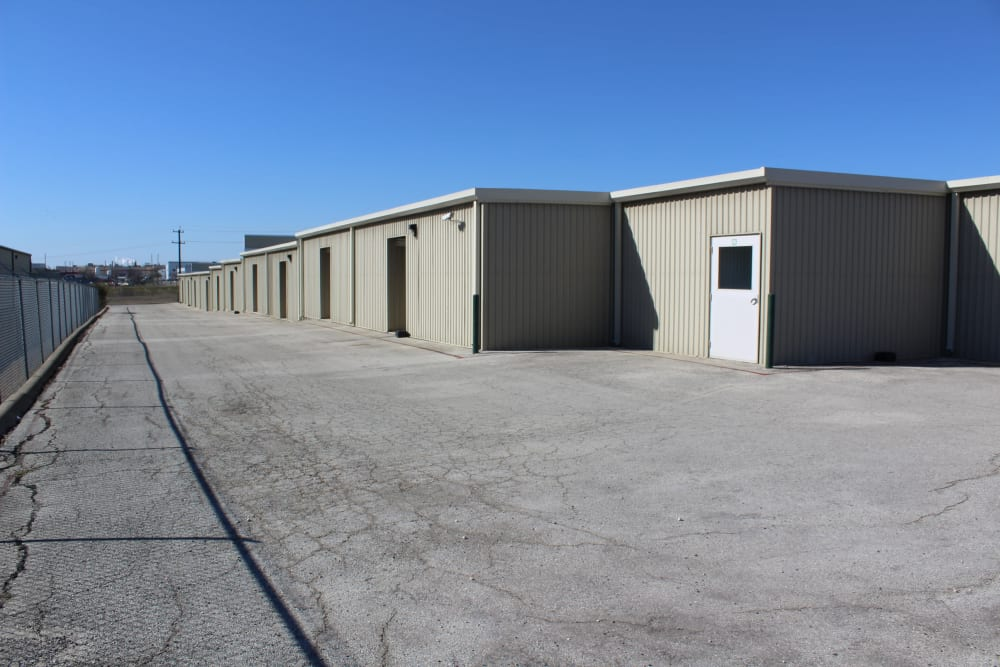 Drive way and buildings where customers keep belongings for storage at Maximum Mini Storage Rittiman