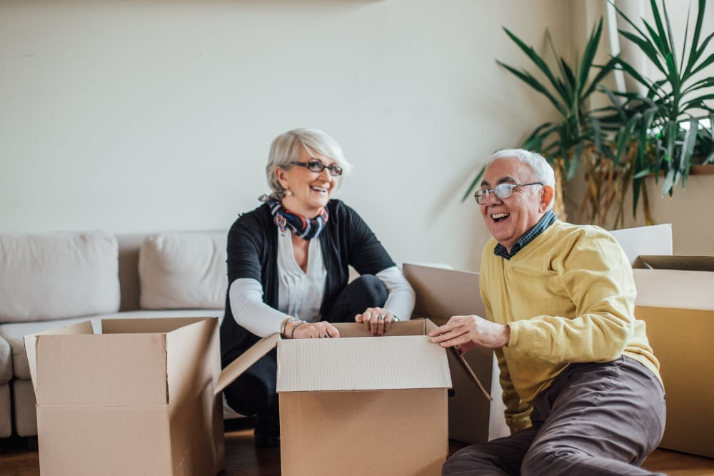 Two smiling senior citizens getting ready to store some belongings at Trojan Storage in Salinas, California