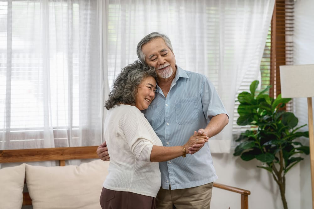 Two residents dancing in their apartment at York Gardens in Edina, Minnesota