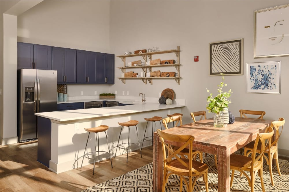 Very cute modern style kitchen with breakfast bar at Seville Uptown in Dallas, Texas