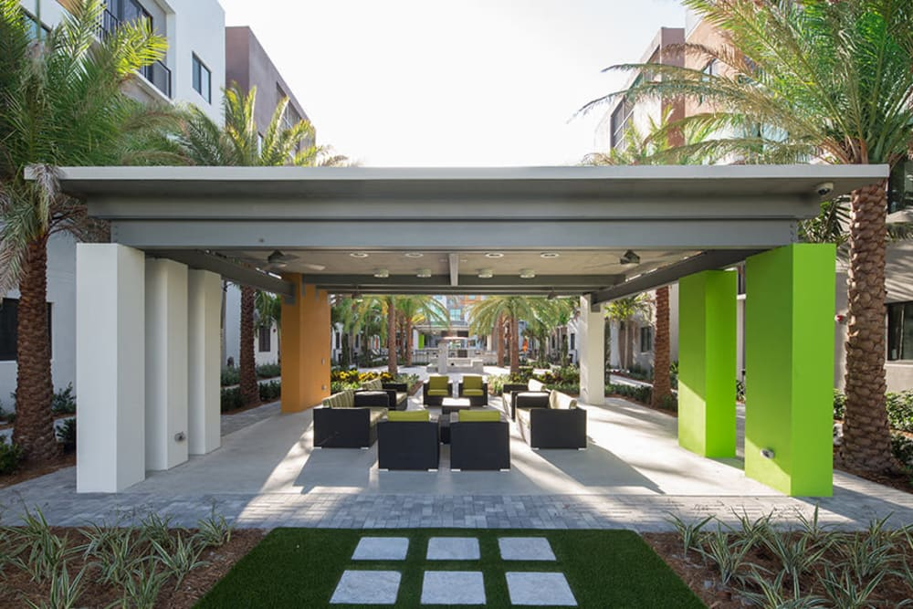 Take a break at the outdoor lounge area with firepits at University Park in Boca Raton, Florida
