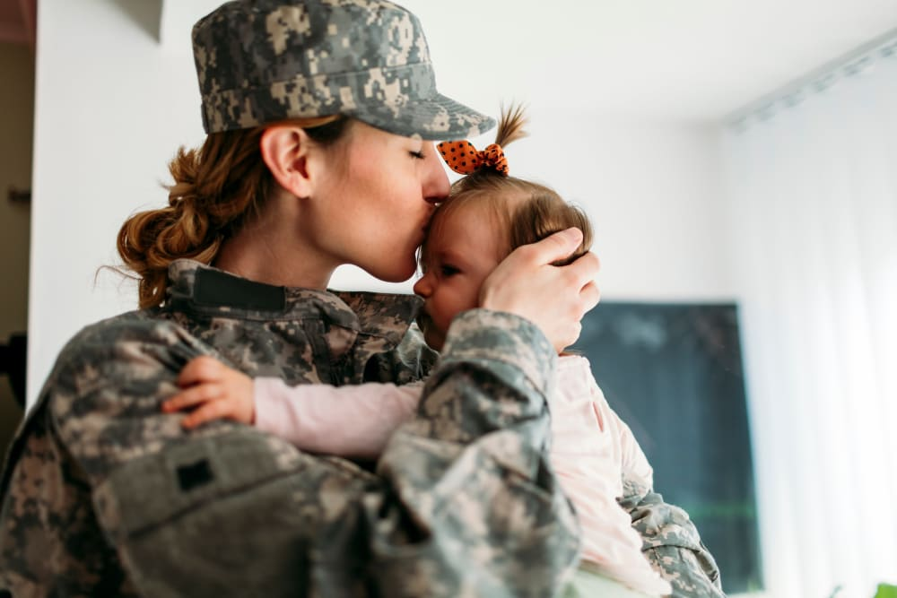 A military member and her baby near Devon Self Storage in Pearland, Texas