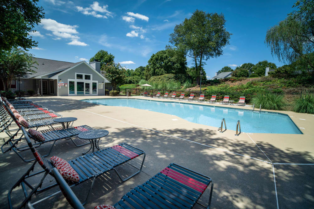 A large swimming pool with a sundeck at 200 Braehill in Winston-Salem, North Carolina