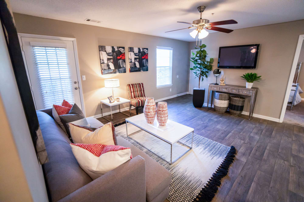 A living room with a ceiling fan at 200 Braehill in Winston-Salem, North Carolina
